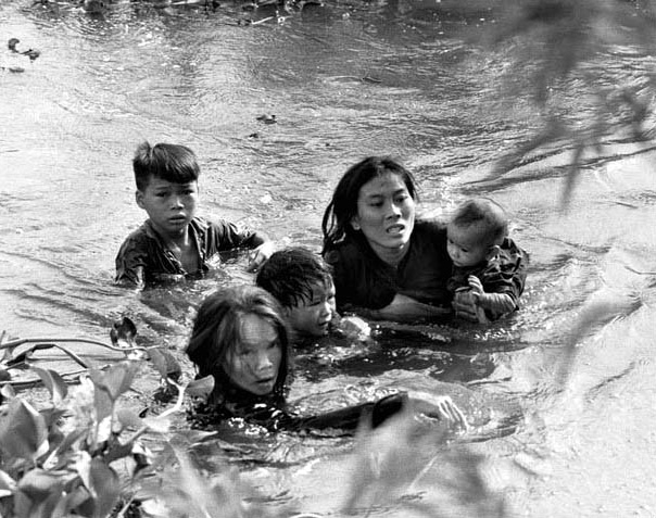 Vietnamese Mother and Children Flee Village Bombing