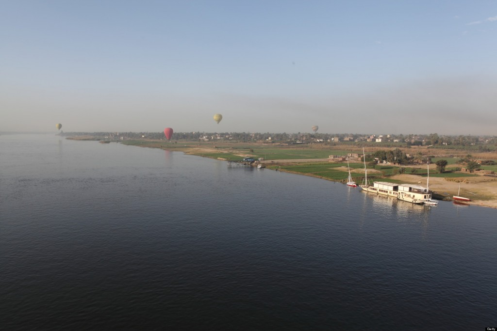 [UNVERIFIED CONTENT] A hot air balloon flight over River Nile in the early morning.