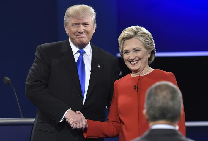 Democratic nominee Hillary Clinton (R) shakes hands with Republican nominee Donald Trump during the first presidential debate at Hofstra University in Hempstead, New York on September 26, 2016. / AFP / Paul J. Richards (Photo credit should read PAUL J. RICHARDS/AFP/Getty Images)